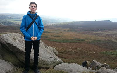 That's me in front of a great view of a valley located in the Peak District.