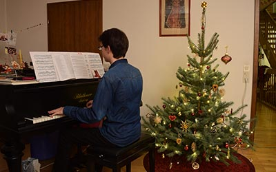 Time to play a Christmassy tune on our grand piano! I look forward to celebrating Christmas with my family.
