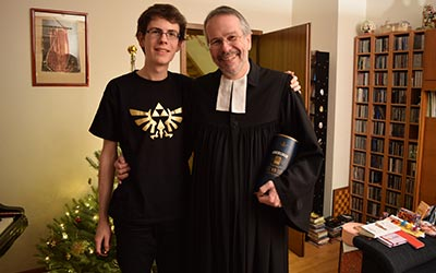 This is a lovely picture with my father after he returned from the Christmas service. I'm wearing my new T-Shirt with the epic Zelda symbol!